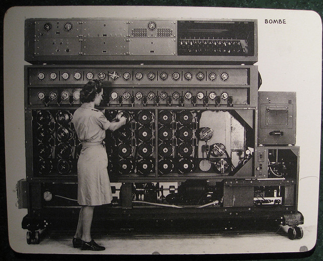 Woman programming a huge early computer